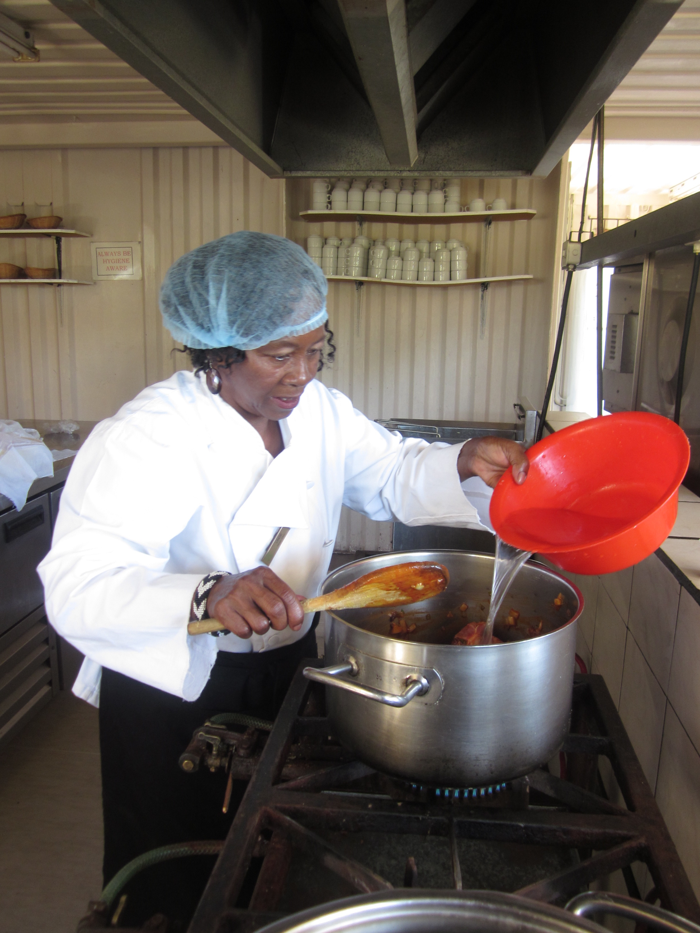 Mama Lindy teaching African Cooking classes in Langa